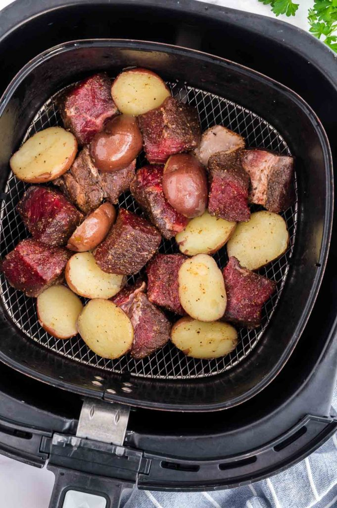 raw ingredients for steak tips and potatoes in the air fryer