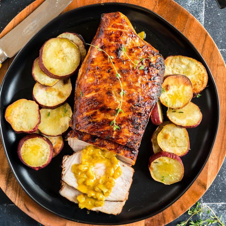 Serving air fryer pork tenderloin with potatoes