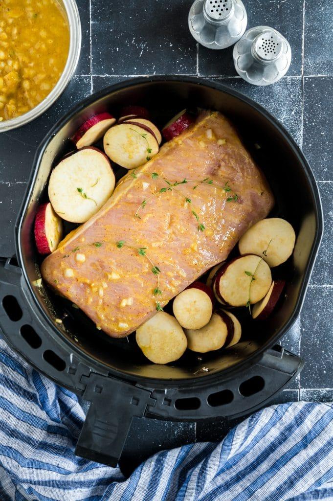 marinted pork in air fryer basket