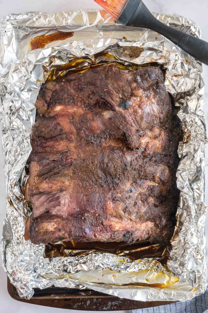 opening op the foil to caramelize the ribs