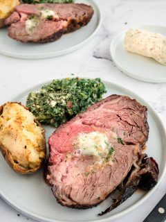 plate of grilled prime rib on a table
