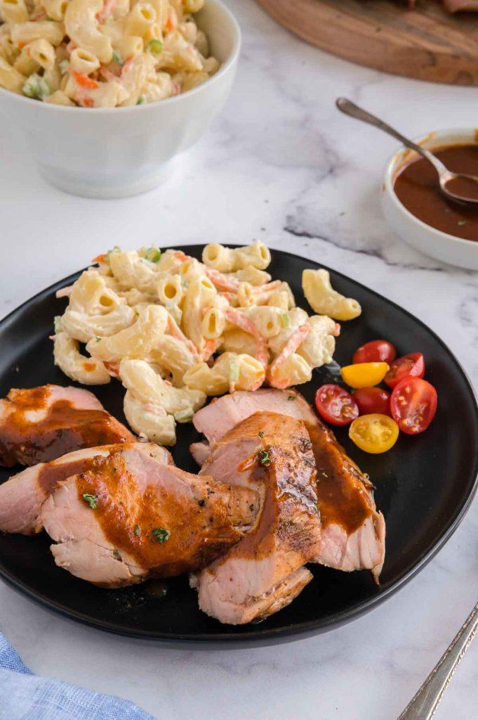 dinner plate with pork tenderloin and make ahead pasta salad