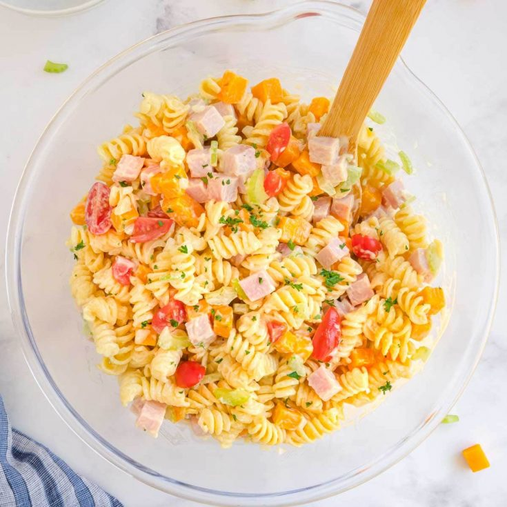 Closeup of pasta salad in a glass bowl