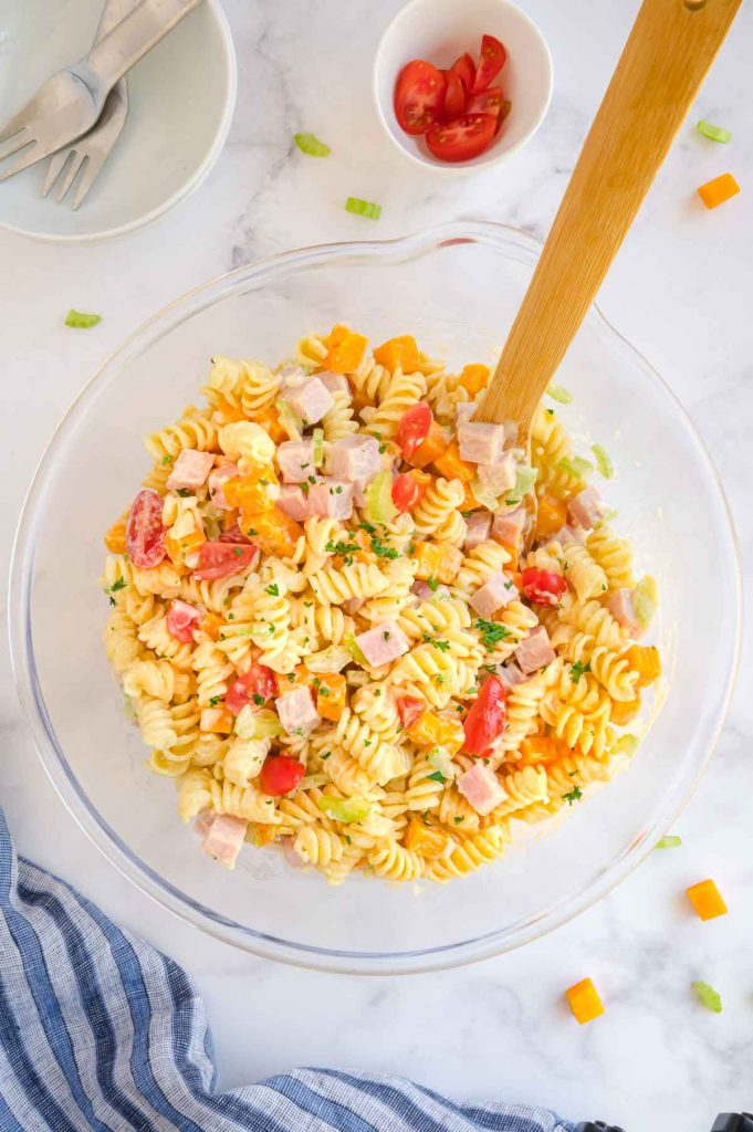 Stirred salad bowl with pasta salad