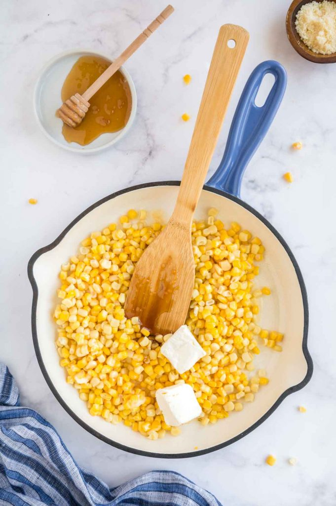 cooked corn with honey and cream cheese added