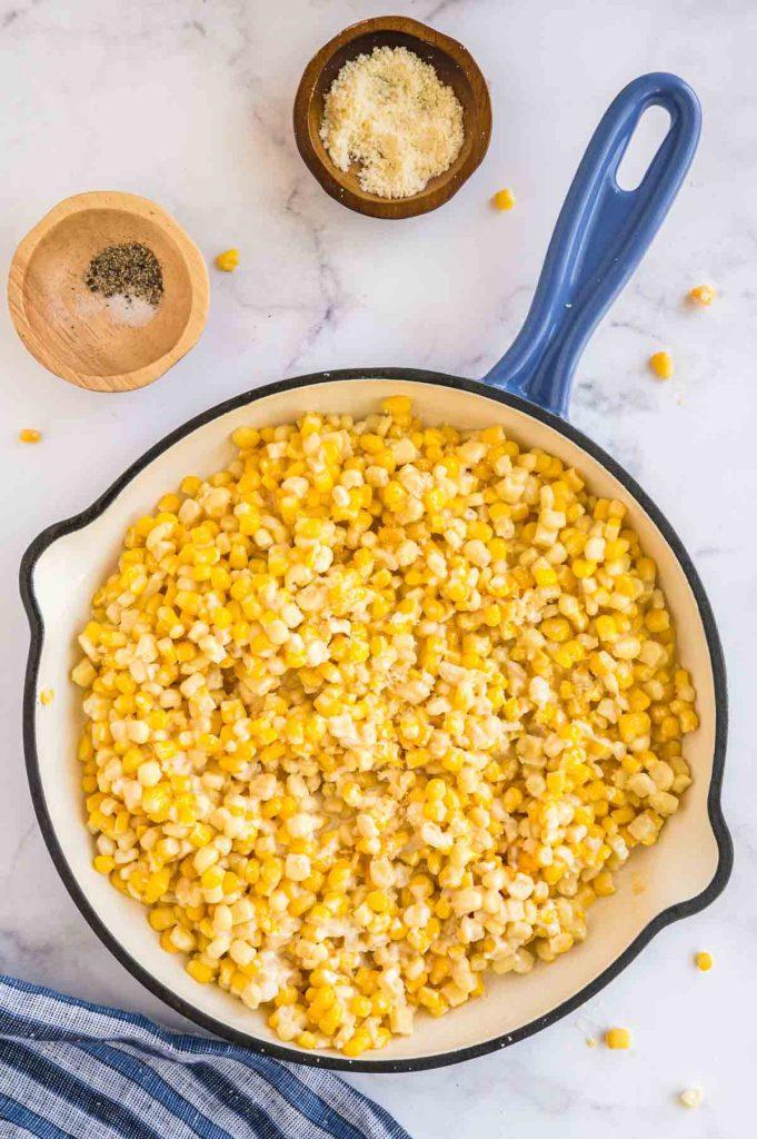 skillet full of parmesan honey butter corn