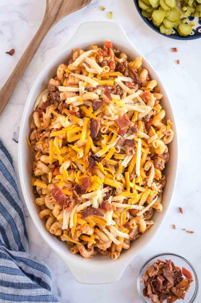 baking dish with mixed pasta and cheeseburger stuffs