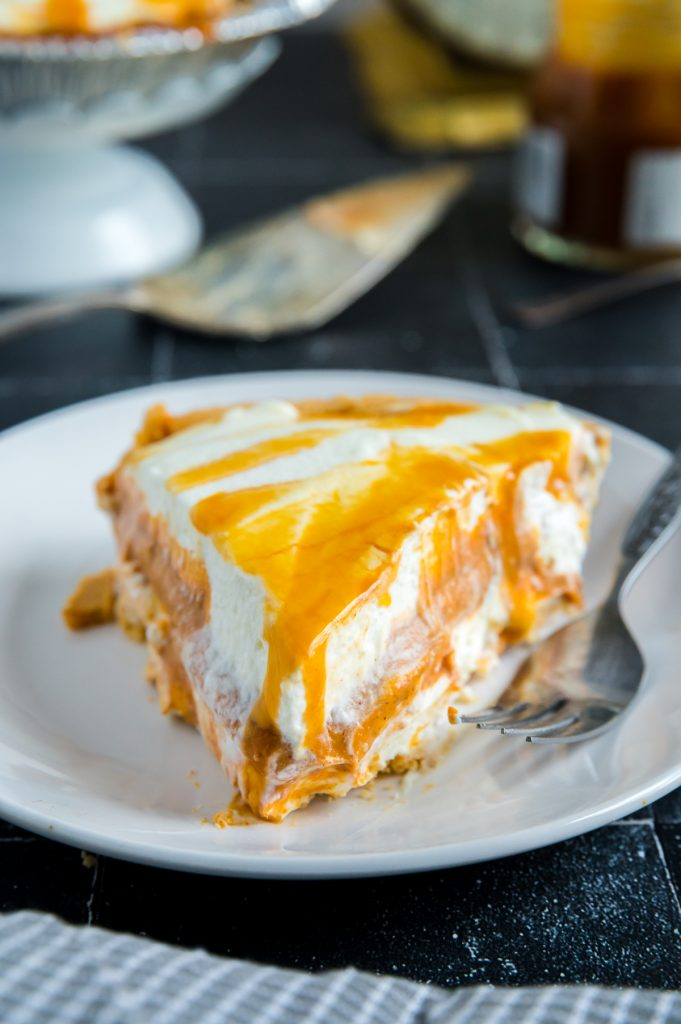 no-bake pumpkin cheesecake pie with salted caramel over the top